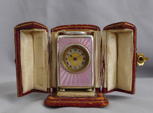 Pink guilloche enamel and silver gilt sub-miniature carriage or boudoir clock, original case and key