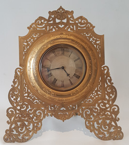 Large Antique English late 19th century ormolu strut clock in manner of Cole.