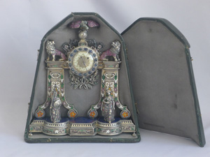Spectacular antique Viennese silver gilt, enamel and jewelled clock modelled as a fire surround