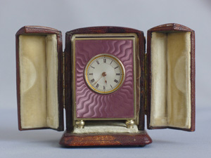 Fine silver gilt, and pink guilloche enamel sub minature carriage or boudoir clock in original case