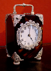 English silver mounted tortoiseshell carriage clock.
