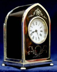 English lancet topped tortoiseshell, silver pique  & silver clock by William Comyns of London.