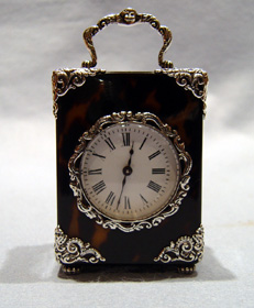 Antique English silver mounted tortoiseshell clock.