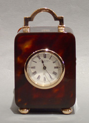 Antique English gold mounted tortoiseshell carriage clock.