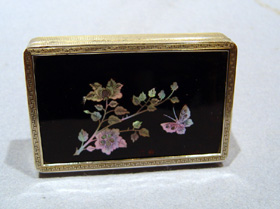 Antique French silver and tortoiseshell card case inlaid with birds and flowers.