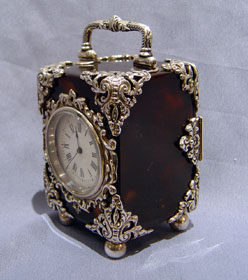 Antique English silver mounted tortoiseshell carriage clock.