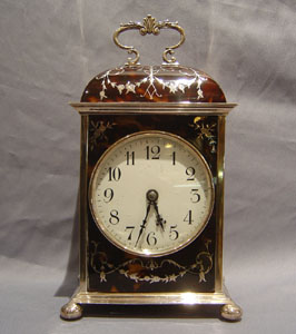 Antique English Dome topped tortoiseshell and silver pique large carriage clock by William Comyns.
