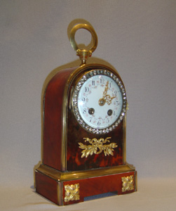 Antique English jewelled scarlet tortoiseshell and gilt bronze clockclock.