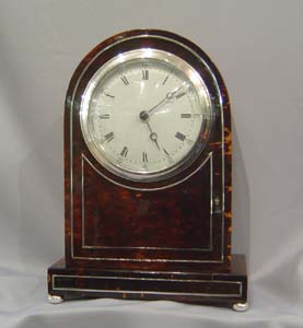 Antique English dome topped tortoiseshell mantel clock.