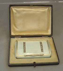 Silver and enamel cased card case in silver with grey guilloche enamel.