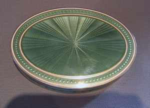 English Edwardian silver gilt and olive green guilloche enamel oval box.