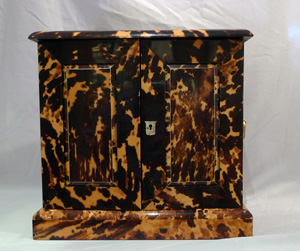 Blond tortoiseshell table cabinet with gilt bronze mounts for correspondence.