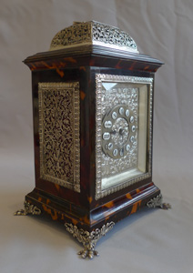 Antique tortoiseshell and cast silver mounted carriage clock in original case.