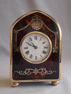 Gold and gold pique and tortoiseshell carriage clock hallmarked for H. Aumont and Co. London 1910.