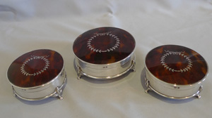 Trio of tortoiseshell silver pique, silver and cut glass powder jars.