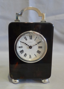 Antique tortoiseshell and silver carriage clock by Asprey of London.