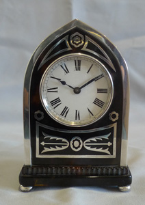 Antique English Gothic design lancet topped  tortoiseshell & silver mounted clock by William Comyns.