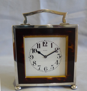 English Art Deco tortoiseshell and silver strut or easel clock.