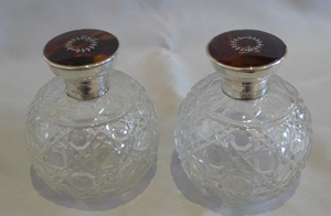 Pair tortoiseshell pique silver and cut glass spherical perfume bottles.