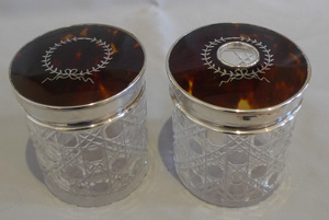 Pair tortoiseshell pique, silver and cut glass tall dressing table jars.