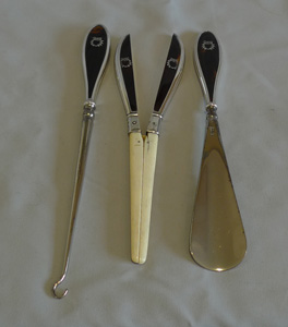 English ivory and silver and tortoiseshell silver pique glove stretcher, button hook & shoe horn.