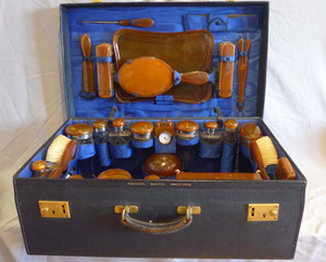 Travelling Dressing set blond tortoiseshell, gold and silver and cut glass.