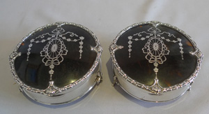 Pair tortoiseshell, silver and silver pique boxes by Mappin and Webb.
