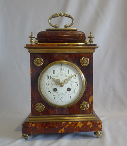 Antique Blond tortoiseshell and gilt bronze bracket or mantel clock in Queen Anne style.