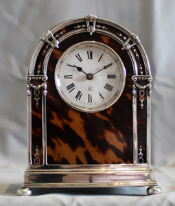 English George V silver and tortoiseshell mantel clock.