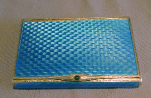 Guilloche enamel and silver card case with saphire button.