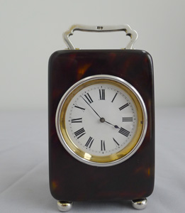 A fine silver mounted tortoiseshell carriage clock.