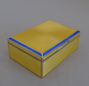 Silver and imperial yellow and blue guilloche enamel Art Deco box.