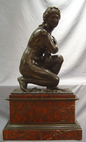 Grand Tour Antique Italian bronze of Kneeling Venus on rouge marble base.