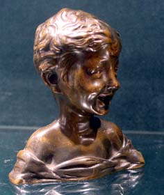 Antique French small laughing girl bronze head.