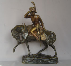 Antique bronze of Napoleonic cavalry officer on his charger signed R. Nannini.