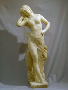 Antique Art Nouveau alabaster sculpture of semi draped woman.