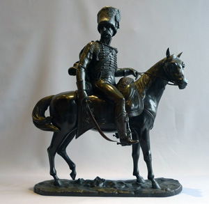 Antique bronze of a French or Russian hussar on horseback.