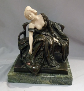 Art Nouveau bronze and ivory sculpture of girl on a bench by P Tereszczuk.