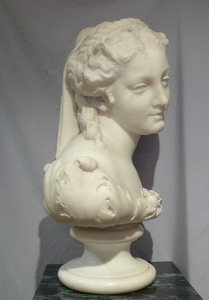 Antique Italian carrera marble bust of Flora on circular socle.