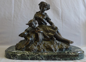 Antique bronze of woman and child mid 19th century on antique vert marble base.