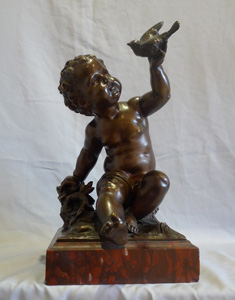 Antique French bronze of putti signed A Moreau, on rouge marble base