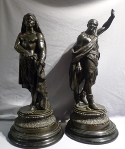 Antique pair of figures depicting America and Africa in bronzed spelter of fine quality.