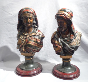 Pair of orientalist cold painted busts of a man and woman.