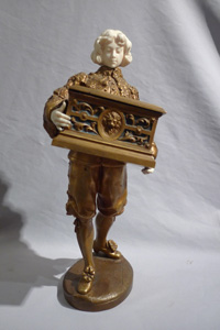 Ormolu and ivory figure of page holding casket with watercolour on ivory signed Rene Marquet.