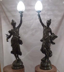 Antique pair of figural bronze lamps of classical semi draped maidens..
