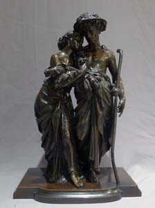 Antique French patinated bronze sculpture of man and woman signed Moreau.
