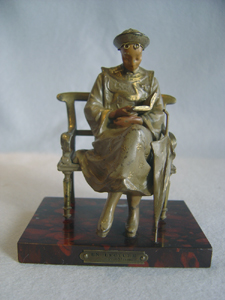 Cold painted bronze of oriental student on rouge marble base signed Maxim.