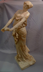 Art Nouveau alabaster figure of a maiden with her dress slipping.