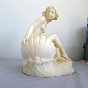 Antique Art Nouveau figural alabaster lamp of Venus in her shell.