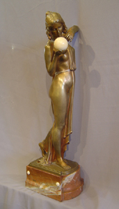 Art Deco bronze of a woman with ivory ball.